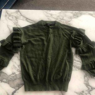 Grön stickad tröja