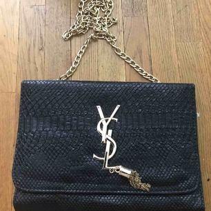 OANVÄND Handväska från YSL - FAKE