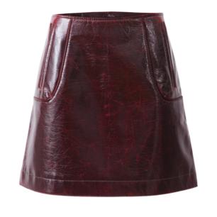 Lackad kort kjol i mörkrött fuskläder från H&M Studio AW19. strl 34 / XS. Fint skick.