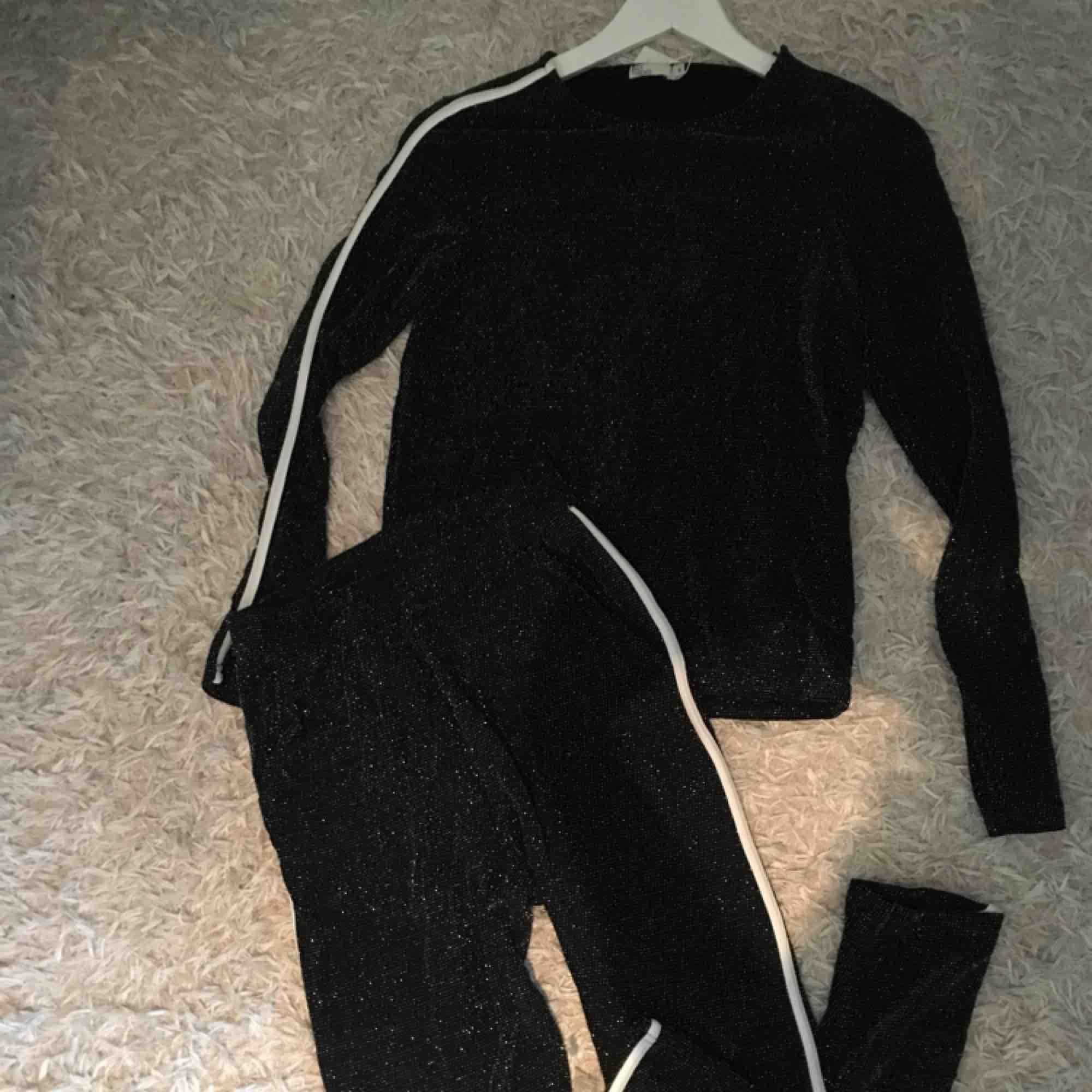 Oanvänt glitterset från Nelly.com storlek S. Övrigt.