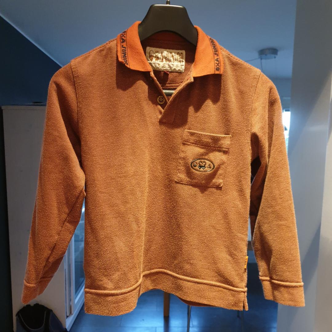 Brun / orange tröja. Barnstorlek 10 (10 år?). På kragen står det oxa junior. Tröjor & Koftor.