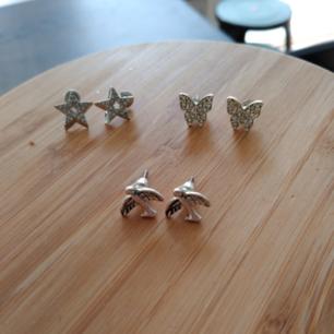 3 stycken örhängen, stjärna, fjäril och fågel. 30kr per örhänge. Paketpris 80kr