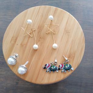 3 stycken örhängen. Stjärna med pärla, stor pärla och elefant. 40kr per örhänge. Paketpris 140kr.