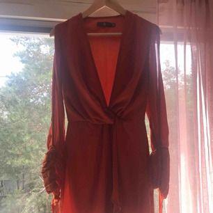 Orange dress. Have worn it a few times. Really nice dress.