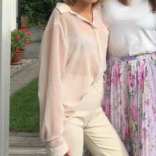 Ljusrosa genomskinlig skjorta/blus