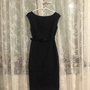 Black classic thicker stretchy cotton dress with a belt.