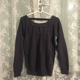 Soft cotton sweater with open back. Size M but I'd say rather S.