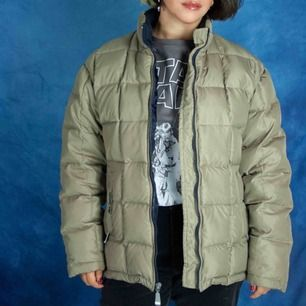 Natural down puffer jacket in olive green size S-M SIZE Label: 38, fits best M or loose S Model: 160/S-M Measurements: length: 66 cm pit to pit: 56 cm Free shipping