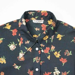 Vintage 80s cotton autumn floral patterned Cacharel shirt in black size S  Tiny holes on the chest (see photo) SIZE No label, fits best S Model: 171/S Measurements:  Length: 61 cm pit to pit: 52 cm sleeve length: 61 Free shipping