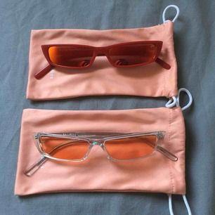 Acne Studios Agar. Röda med orange spegelglas & transparenta med rosa-ish tonat glas. I nyskick. 500:- för ett par.
