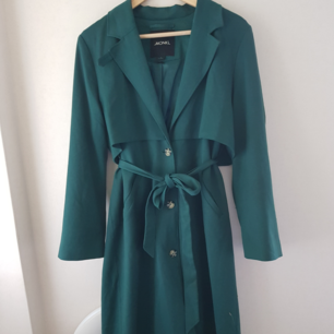 Long, green autumn/spring coat from Monki. I have mended some holes in the pockets but otherwise good condition.