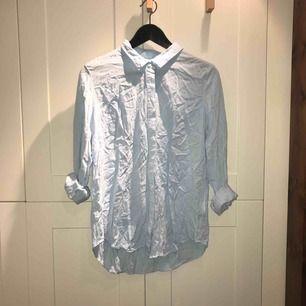 Ljusblå skjorta i stl. 40 från Gina Tricot, 100 % ramie