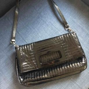 FCUK foldable shoulder bag. Used but in good condition. Size of a magazine. Buyer pays for postage.