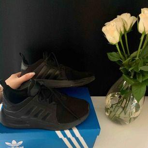 Adidas x_plr i storlek 36 färg svart. Inte mycket använda.