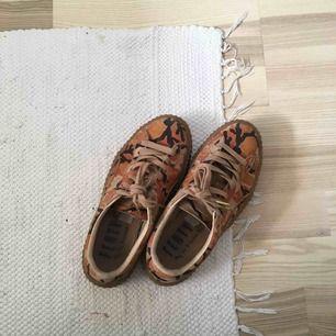 FENTY by Rihanna  PUMA oranga camouflage sneakers
