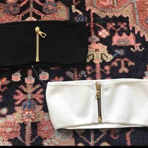 Stretchiga toppar från Balmain x H&M kollektionen, aldrig använda! Den vita har ingen etikett, bara den svarta. 100 kronor styck! Frakt: 40kr Längd är ca 58 cm Bredaste punkt är ca 14 cm