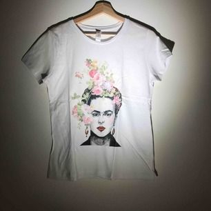 A 100% Cotton T-shirt, never worn, printed with the iconic artist Frida Kahlo!