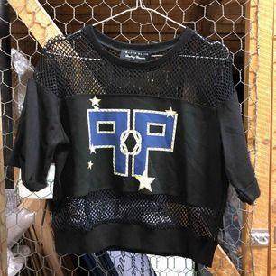 Sweatshirt med mesh.