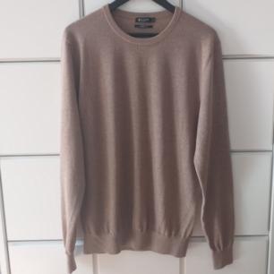 Pullover i fint skick storlek L.  100 % ull