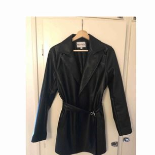 never worn it, it's too small for me. size 36 NA-KD Belted Pu-leather jacket (black)  Go on their website if you need to see it on the model. It looks and feels like real leather but it's faux leather.  799kr new, selling for 500kr 🙂