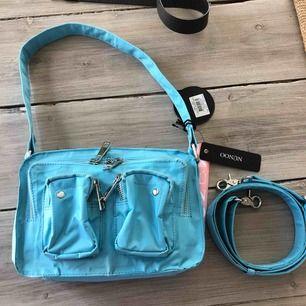 Säljer min helt nya blåa fina nunoo väska, har prislappen kvar! Mycket fin väska som jag tyvärr säljer:( hoppas nån vill köpa!