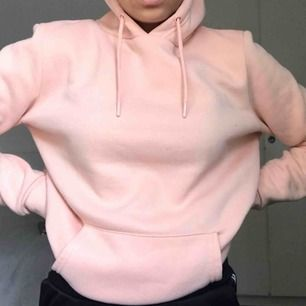 Peach färgad hoodie