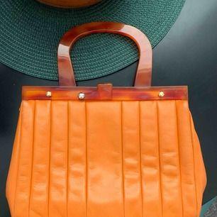 Snygg orange handväska