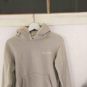 Beige hoodie från New Black