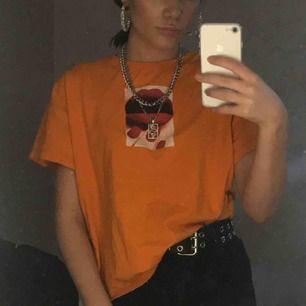 Orange T-shirt! 42kr frakt