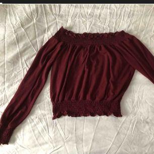 Blus/ tröja av kortare modell