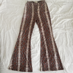 Elastic hippie-style trousers (high waist), size M - feels more like L.  Post included.
