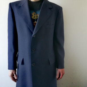 Very unique hand tailored coat in color blue with original inside, like brand new !!! Size XL.