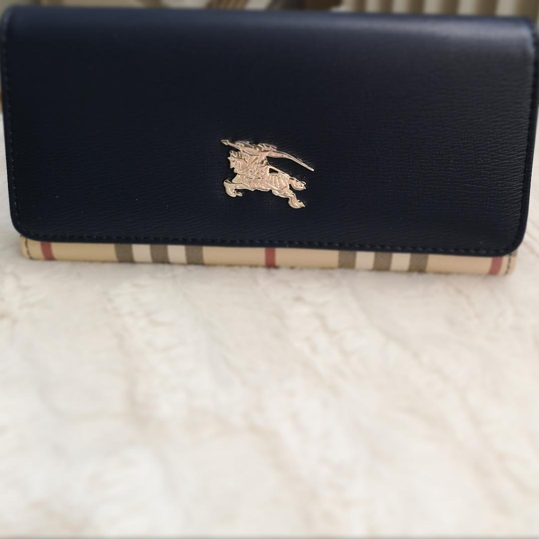 Ny Burberry plånbok färg:marinblå . Accessoarer.