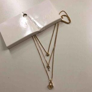 Guldigt halsband, lapp kvar, aldrig använd