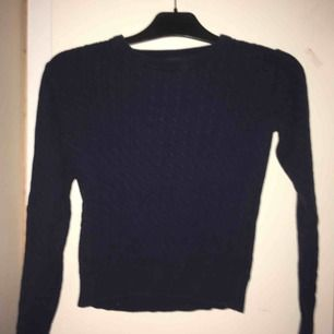 En fin stickad tröja som tyvärr har blivit för liten!