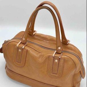 Longchampväska i brunt skinn