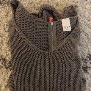Grå stickad MYSIG tröja som absolut inte sticks, använd ett fåtal gånger. Köparen står för frakt.