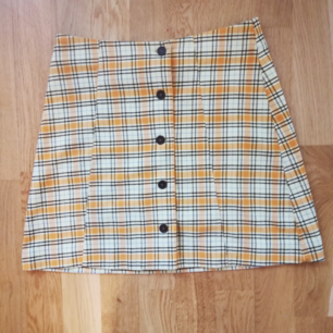 Mini skirt from Monki in size 38, but may fit size 36 as well. I slighly moved buttons as you can see on number 3. Waist is 68cm now. Post cost approx 30  :- extra !!   Great condition.