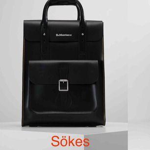 Söker dr martens backpack i svart eller vinröd färg!