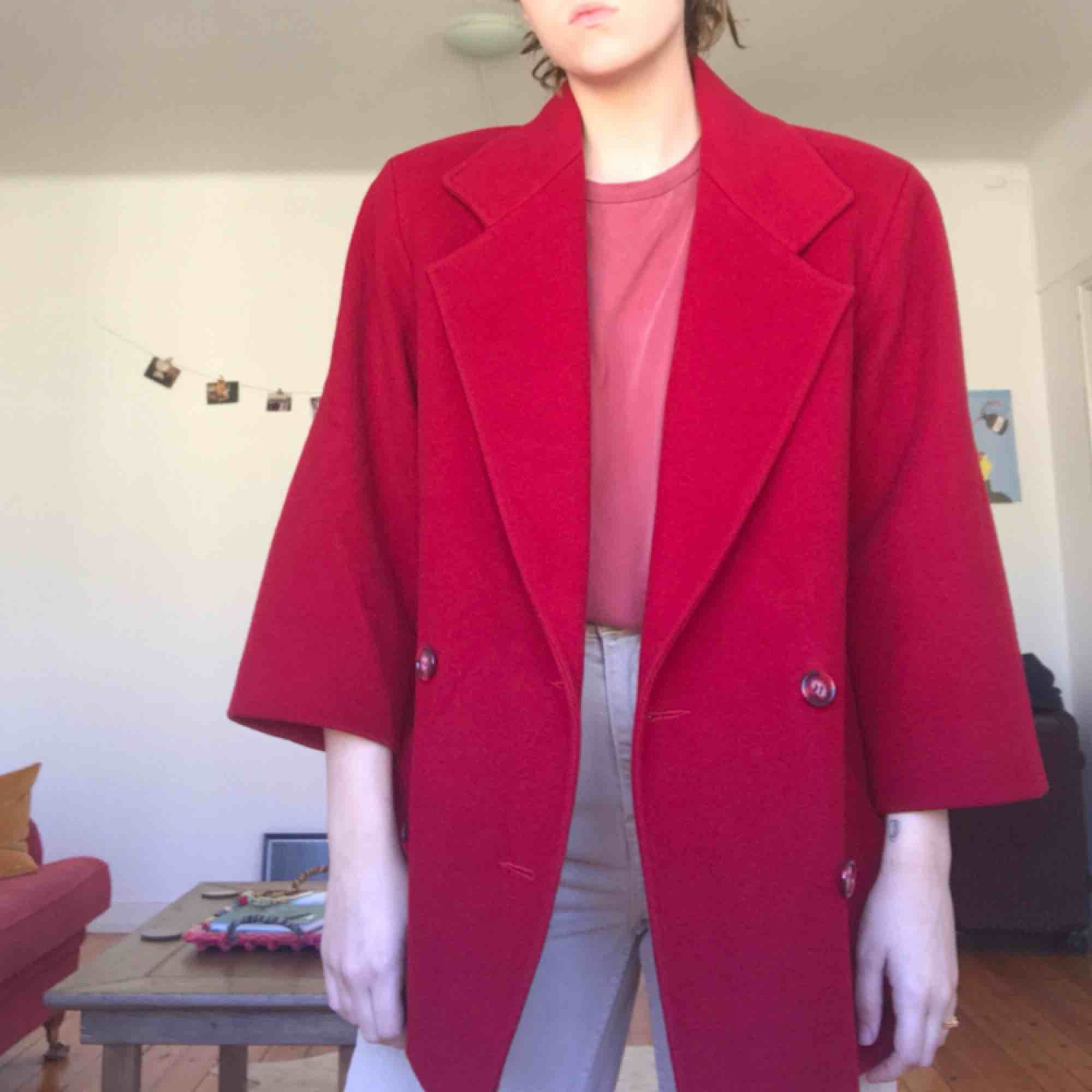 perfect condition! beautiful red and buttons so unique, marble red. bought at a vintage store and have only worn once! plus SICK SHOULDER PADS!. Jackor.