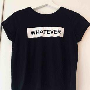 """T-shirt med trycket """"whatever"""" på från Gina Tricot. Använd några gånger. Storlek S, 30kr. Frakt tillkommer på 42kr."""
