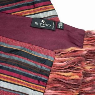 Vintage Etro silk striped patterned scarf with fringe trim in burgundy. A thread pull on the back side. SIZE & FIT Model: 165/XS Measurements:  32 x 134, trim: 8 Free shipping! Read the full description at our website majorunit.com No returns.