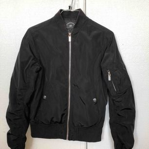 3 years old, small form fitting bomber jacket, worn maybe 10 times, okay condition.