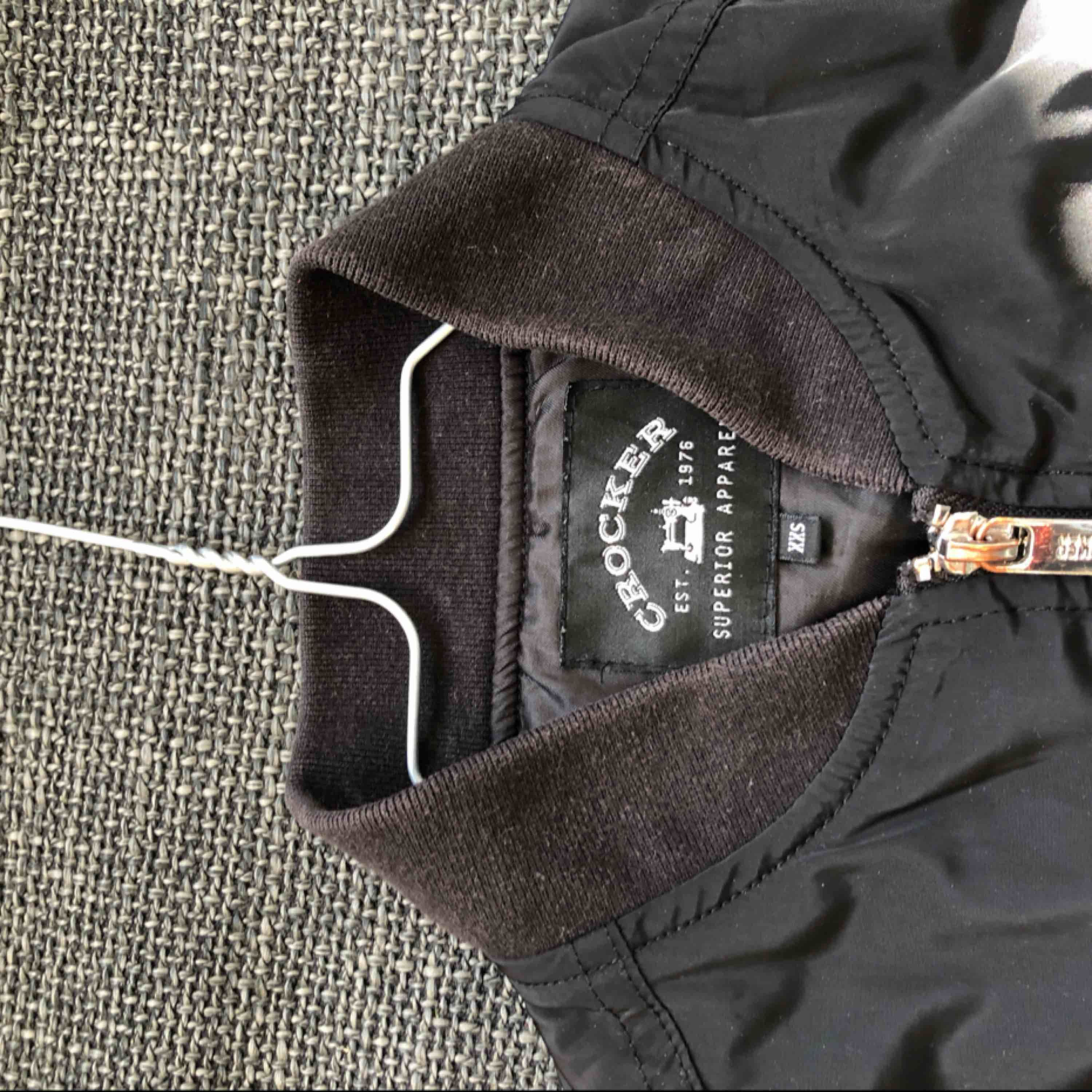 3 years old, small form fitting bomber jacket, worn maybe 10 times, okay condition. . Jackor.