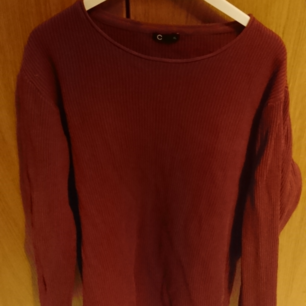 XL male shirt. Has a striped texture and is finely knitted together. Whine red and no damages.