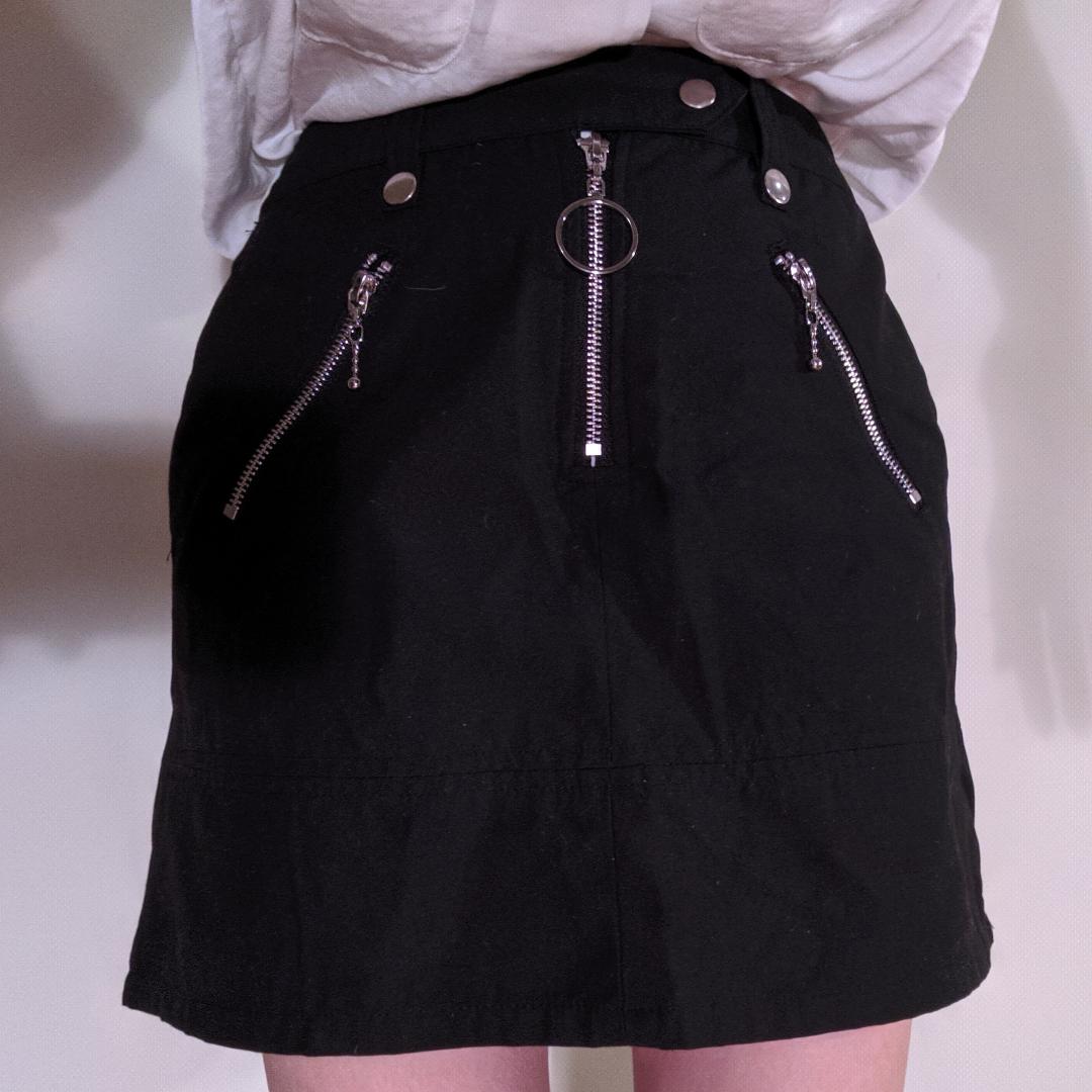 Kort kjol från Wego i Tokyo. Storlek XS-S.  Aldrig använd  Har inbyggda