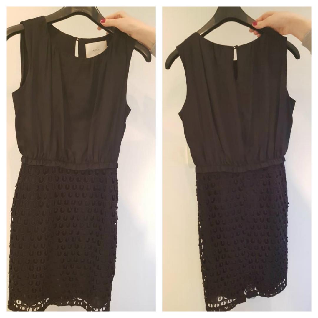Klassisk svart klänning med en twist från MAYLA. Perfekt till alla höstens och vinters tillställningar. Använd 1 gång som ny. Storlek 34. 100 % Siden. Dold dragkedja i sidan. Nederdelen har
