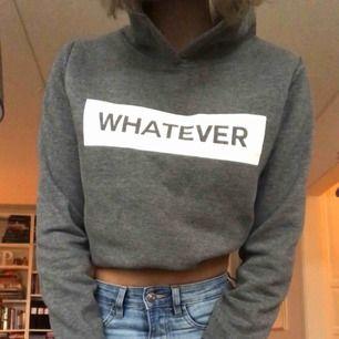 """Grå hoodie från Gina tricot med texten """"whatever"""". Använd några gånger men i fint skick. Nypris 250kr. Jättemysig inuti och perfekt nu till hösten och vintern🥰 Kan mötas upp i Uppsala eller frakta!"""