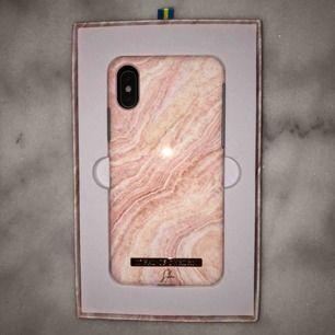Ideal Of Sweden - Rosy Reef Marble Mobilskal iPhone XS Kostar ursprungligen 399kr, jag säljer för 299. Mobilskalet är helt oanvänt, utan skador. Jag säljer pga att jag inte har den mobilen (fick skalet i present)