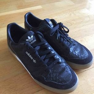 Adidas sneaker, size 41 1/2. Leather and suede, worn once.